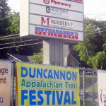 Duncannon AT Festival banner near 2 of of our proud sponsors, Mutzabaugh's Market and Members 1st Credit Union